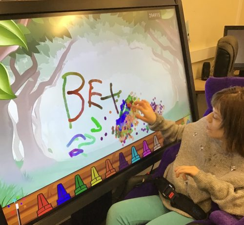 Bex using the CleverTouch screen