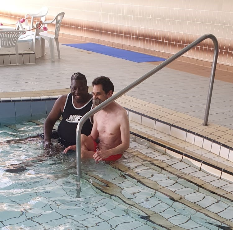 John and his support worker Reg in the pool