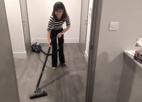 Natalie using her new hoover